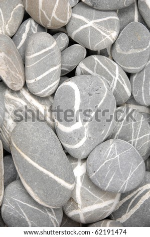 striped pebble sea stone background - stock photo