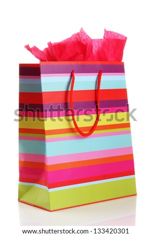 Striped shopping bag isolated on white - stock photo