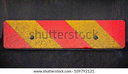 Striped sign on back of large truck tractor - stock photo