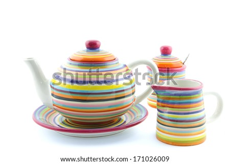 striped teapot, milk jug and sugar bowl isolated - stock photo