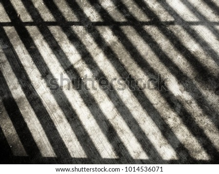 Stripes.  Shadow on a dirty concrette floor