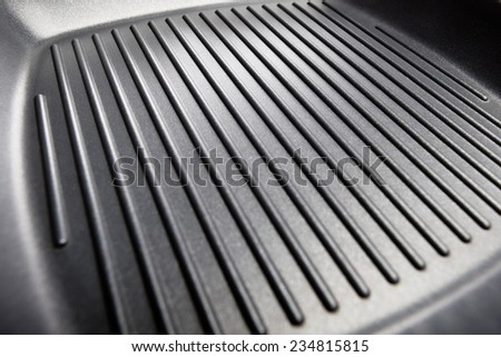 stripped surface of steak frying pan - stock photo