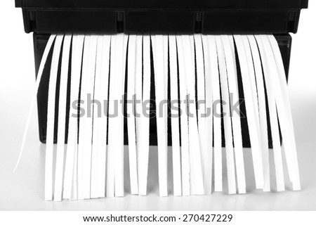 Strips of destroyed paper from shredder, closeup - stock photo