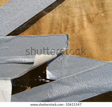 Strips of duct tape on an old wall - stock photo