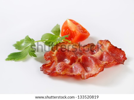 Strips of fried bacon isolated on white background