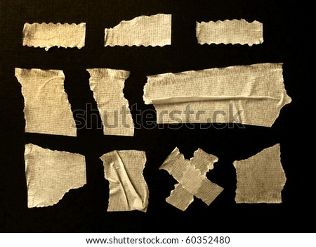 Strips of masking tape. Isolated on black - stock photo