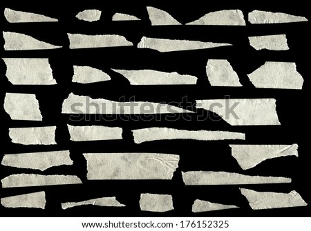 Strips of masking tape isolated on black background - stock photo