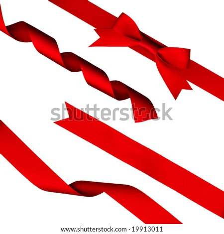 strips of red shiny ribbon and a bow over a white background with Clipping Path - stock photo