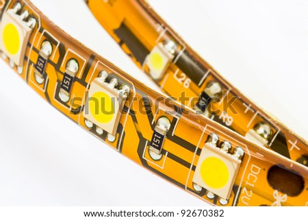 strips with 3-chip and 1-chips SMD LEDs on the white background - stock photo