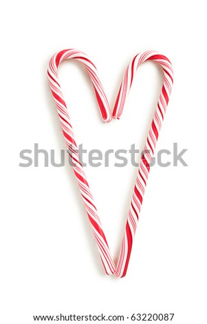 stripy candy cane on white background - stock photo