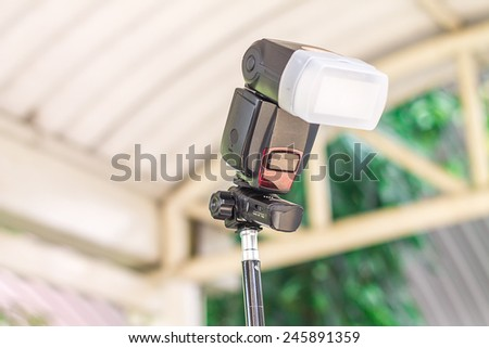 Strobe light in photography. To get a better light. - stock photo