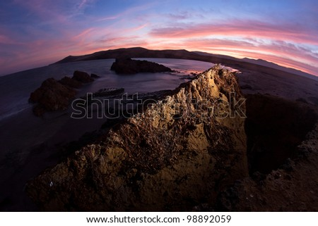 strobist used in landscape photography - stock photo