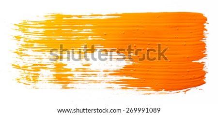 Strokes of orange paint isolated on white background - stock photo
