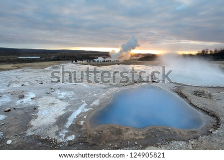 Strokkur Geyser and hot spring in Iceland erupting at sunset in winter