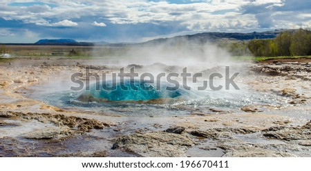 Strokkur Geyser before eruption - stock photo