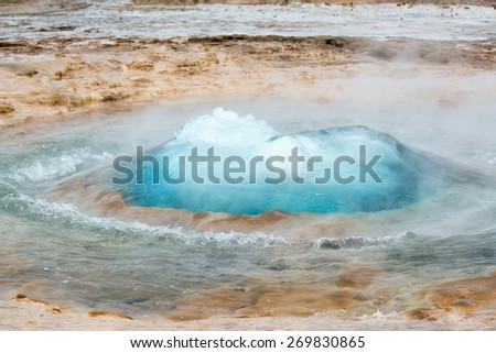 Strokkur geysir bubble ready to blow, Iceland in June - stock photo