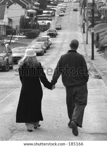 Strolling couple. - stock photo