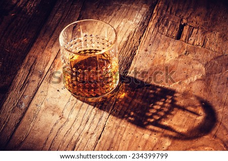 Strong alcohol on a wooden table - stock photo