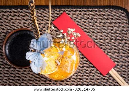 strong alcoholic cocktail in a sushi restaurant on a dark desk - stock photo