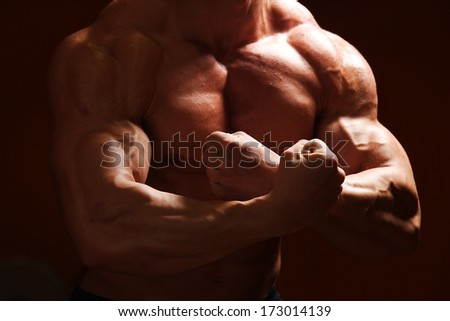 strong and beautiful body of european bodybuilder - stock photo