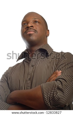 Strong and confident man looking away with crossed arms - stock photo
