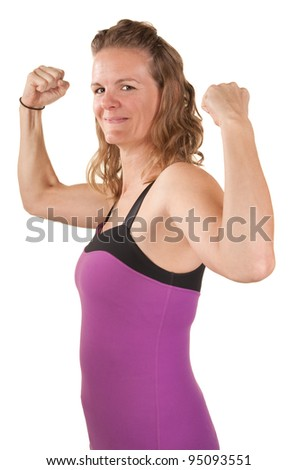 Strong and fit woman shows off biceps