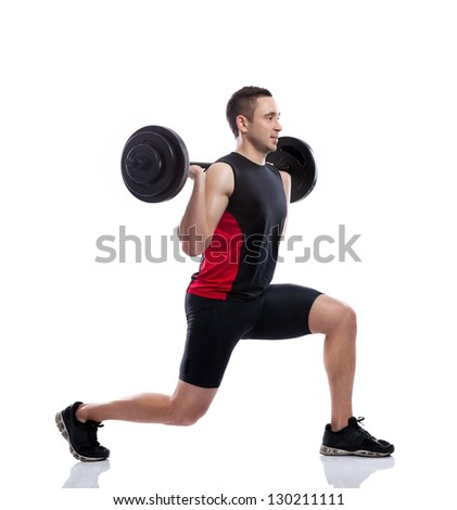 Strong and handsome man lifting weights - stock photo