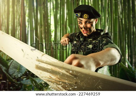 Strong army soldier woman is practicing - stock photo