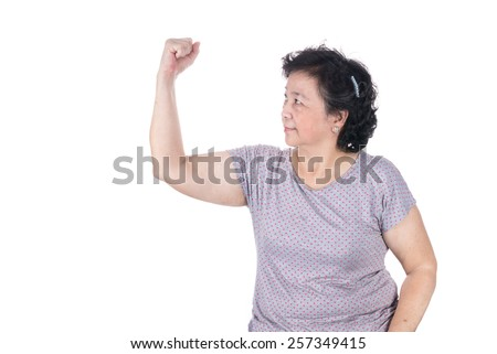 Strong Asian senior female showing off her biceps flexing muscles his arm, isolated on white background. - stock photo