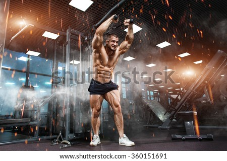 Strong Athletic Man bodybuilderl Torso showing muscles in gym - stock photo