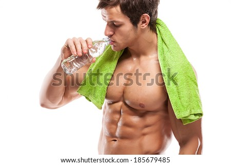 Strong Athletic Man Fitness Model drinking fresh water over white background - stock photo