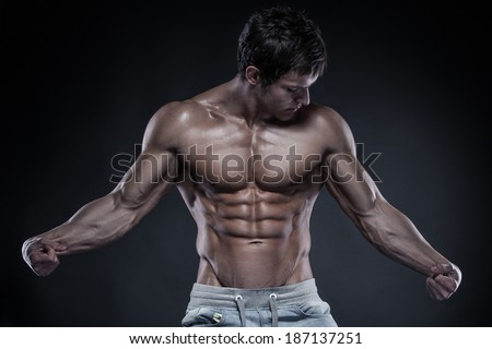 Strong Athletic Man Fitness Model Torso showing big muscles - stock photo