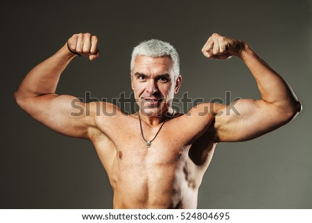 Strong Athletic Man Fitness Model Torso showing flexing bicep muscle (Healthy lifestyle, sports, fitness, strength, beauty)