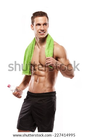 Strong Athletic Man Fitness Model Torso showing six pack abs. holding bottle of water and towel isolated over white background - stock photo
