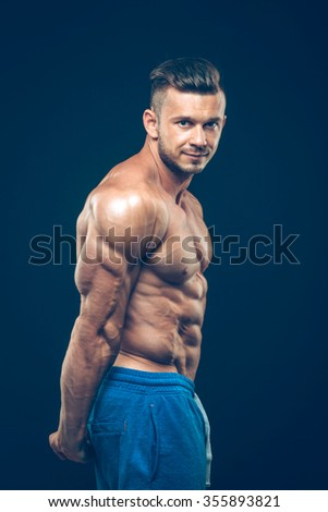 strong athletic man on black background. fitness  - stock photo