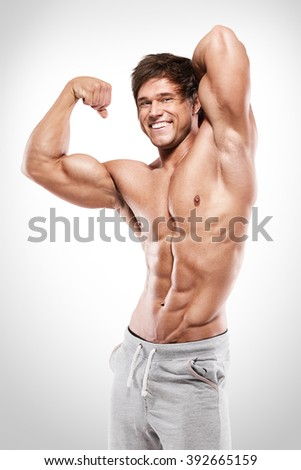 Strong Athletic Man  showing muscular body and sixpack abs over white background - stock photo