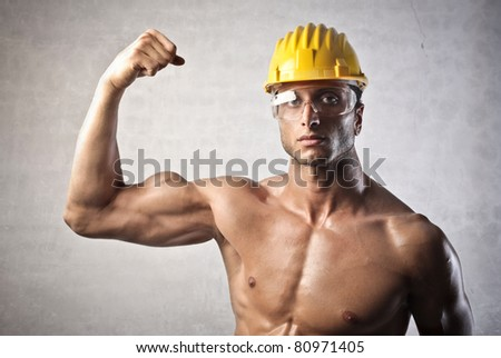 Strong attractive worker - stock photo
