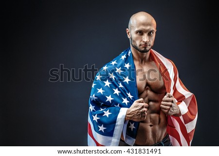 Strong bodybuilder man with perfect abs, shoulders,biceps, triceps, chest - stock photo