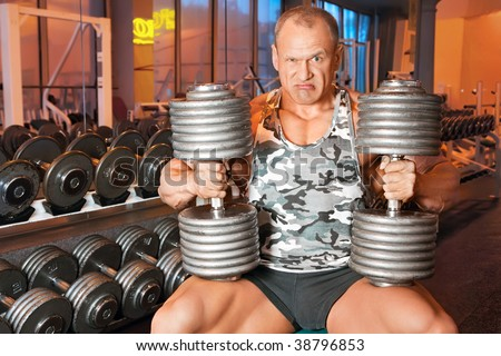 strong bodybuilder training muscles in gym - stock photo
