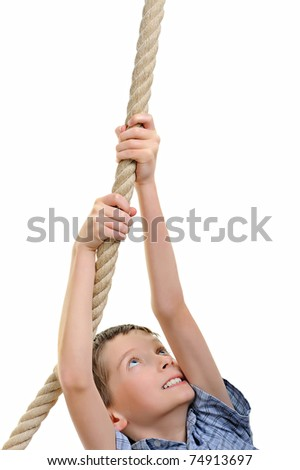 strong boy pulling the rope - stock photo