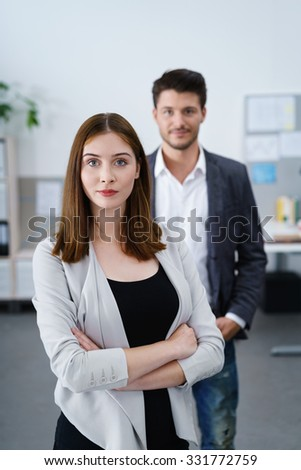 strong businesswoman with crossed arms looking at camera
