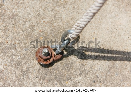 strong chain fastened with cement with nut and connect to rope / Stable, Firmly, Consistent - stock photo