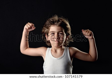 Strong Child showing his muscles - stock photo