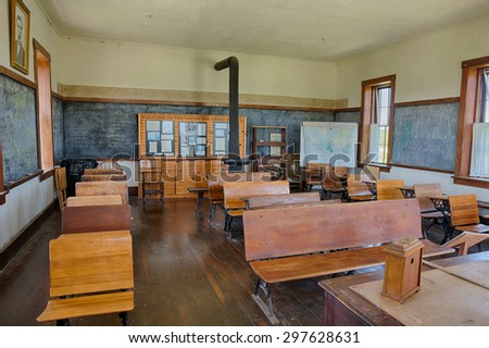 Strong City, Kansas - May 20, 2015: Interior of the historic one-room school, Lower Fox Creek School at the Tallgrass Prairie National Preserve. HDR processed. - stock photo