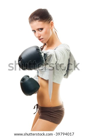 Strong concentrated woman shoots a straight right hand, isolated on white