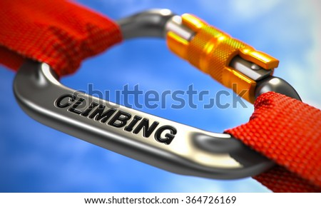 Strong Connection between Chrome Carabiner and Two Red Ropes Symbolizing the Climbing. Selective Focus. - stock photo