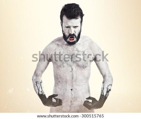 Strong demon over ocher background - stock photo