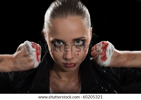 Strong determined angry woman face with fists