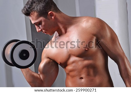 Strong fitness sport man training bicep muscles with gym weights. - stock photo
