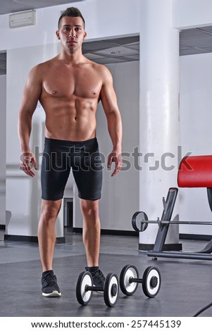 Strong fitness sport man training with gym weights. - stock photo